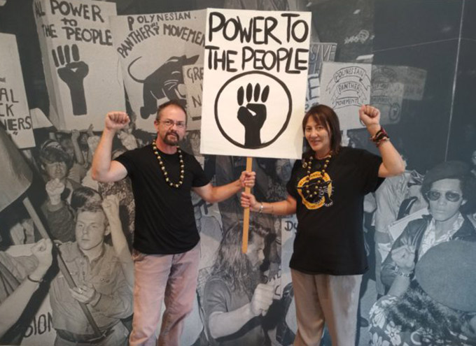 Educate to Liberate curators Pauline Smith and Ari Edgecombe ... a window on the police and immigration crackdown on illegal overstayers in the 1970s. Image: Michael Andrew/PMW