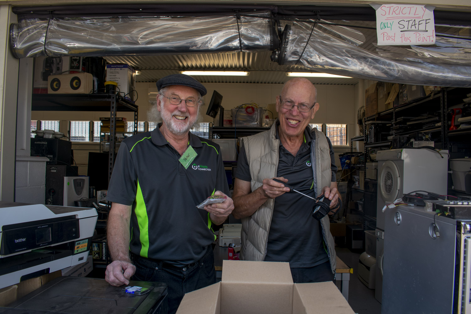 Volunteers Peter Paech and Roger Sanderson enjoy their time at Kenmore's eWaste Connection.