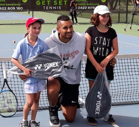 Nick Kyrgios is happy among the kids at an open day for his charity.