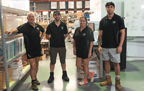 Al Wood, left with some of his staff, is experiencing the biggest customer increase as people stock up on survival supplies. Image supplied