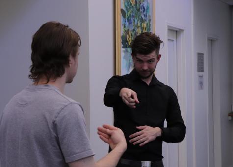 Interpreter talking with Deaf worker