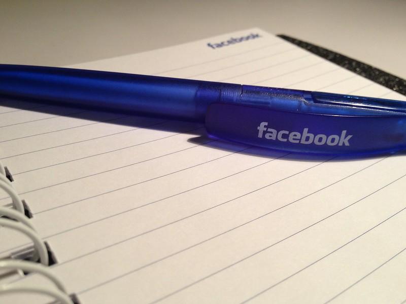 facebook branded pen on facebook branded paper