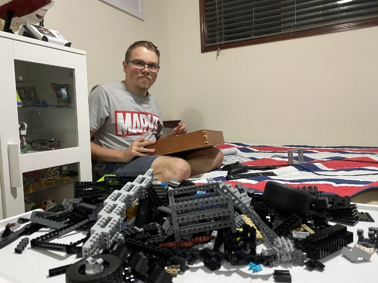 Cameron Royall-West shows off his current Lego project – the Batmobile.