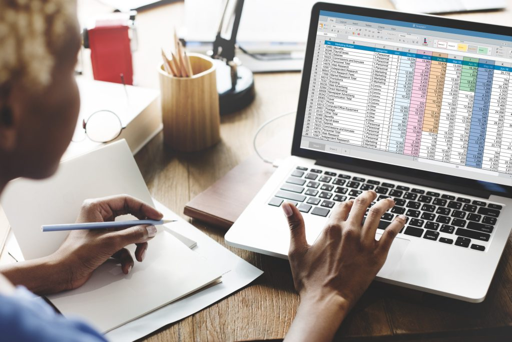 A woman uses a spreadsheet to create financial models for her business. What is financial modeling?