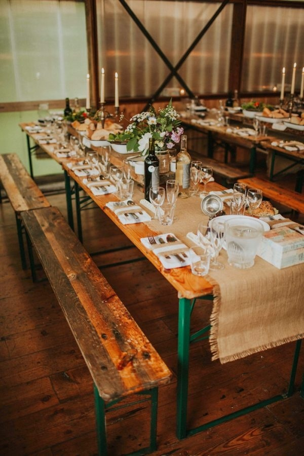 Rustic And Laid Back Barn Reception With Picnic Tables Burlap Runners And Wildflowers