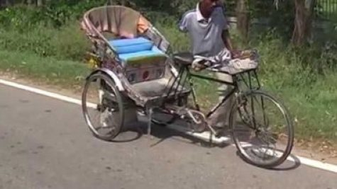 Rickshaw Driver With Only One Leg And Arm
