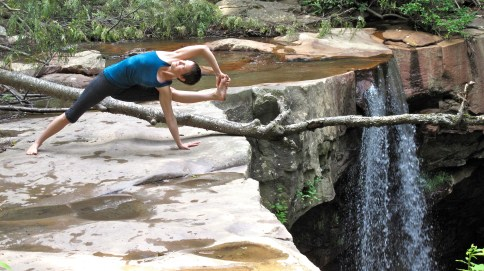 Vishvamitrasana variation on top of a waterfall. Photo by Don