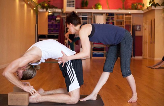Teaching afternoon mysore at Yoga Workshop 2013. Photo by Matt Champoux