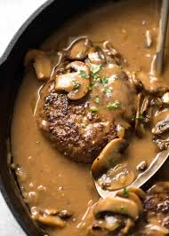 Salisbury Steak with Gravy on a Bed of Garlic Mashed Potatoes