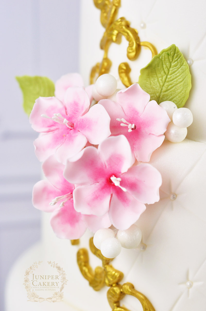 Pink cherry blossom with gold frame wedding cake by Juniper Cakery