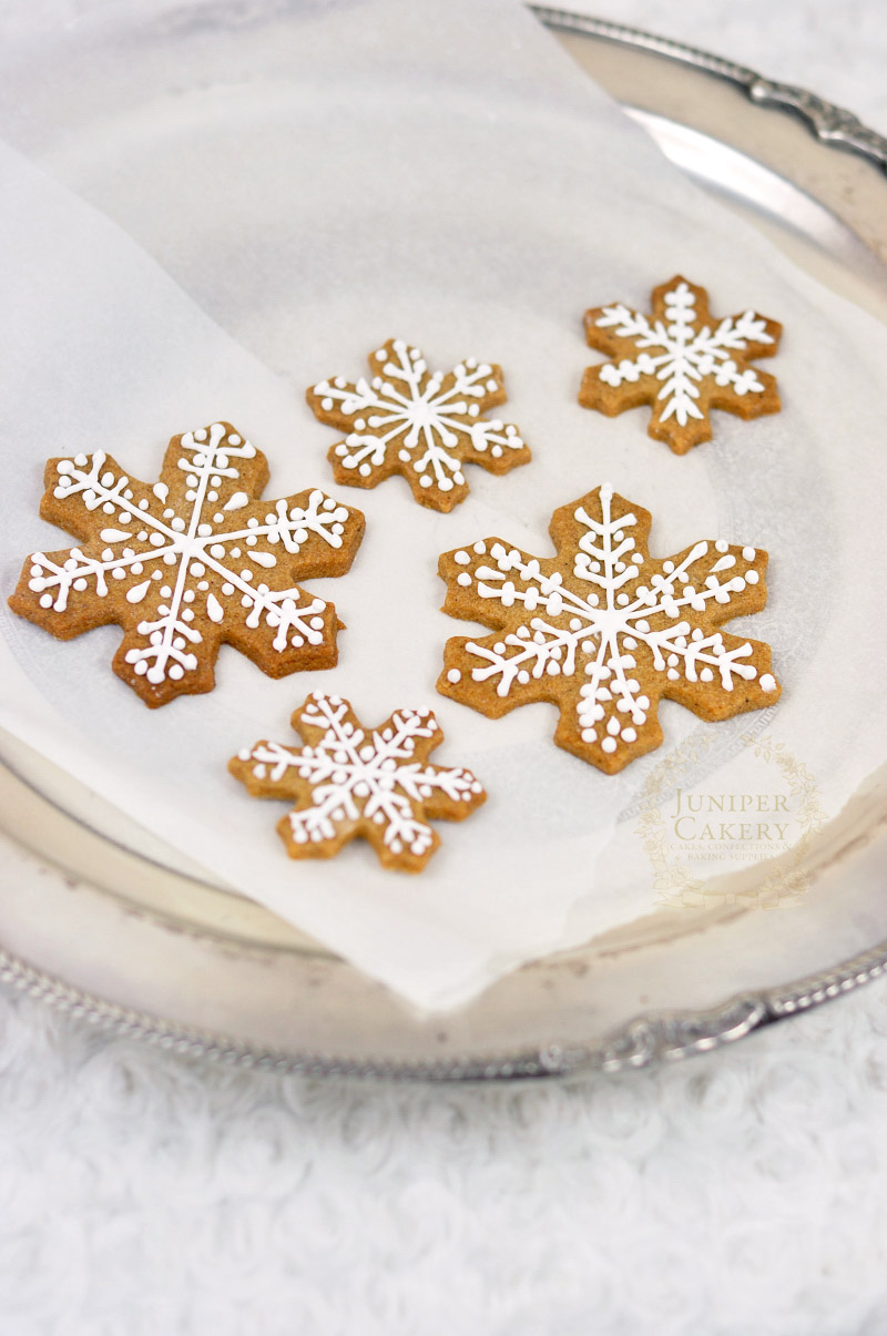 Make some gingerbread snowflake cookies with this recipe by Juniper Cakery