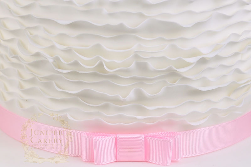 Fondant ruffles on a cake by Juniper Cakery