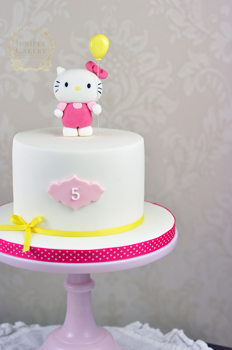 Pink and yellow Hello Kitty cake by Juniper Cakery