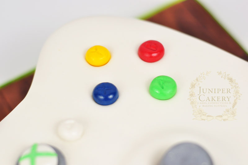 Close up detail of giant xbox controller cake by Juniper Cakery