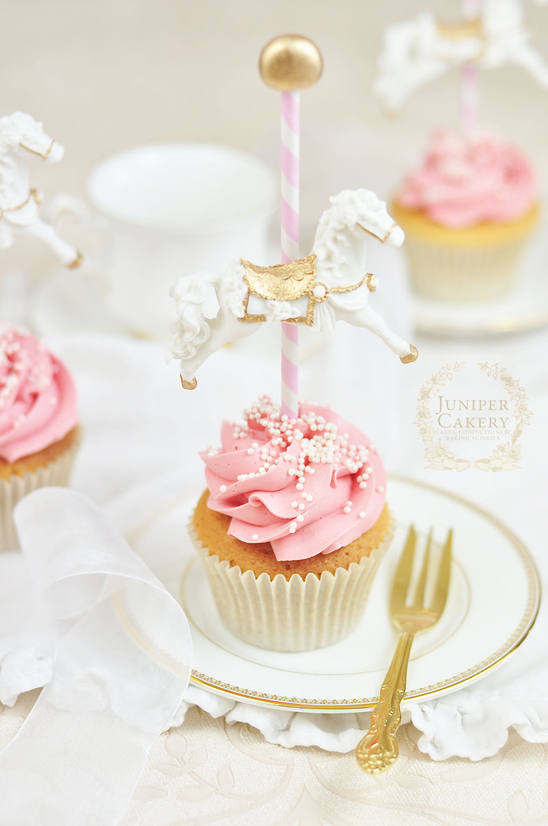Baby shower cupcakes with carousel horses by Juniper Cakery