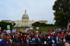Congressmen and almost 200 others wait for their pre-arranged arrest during a rally for immigration reform.