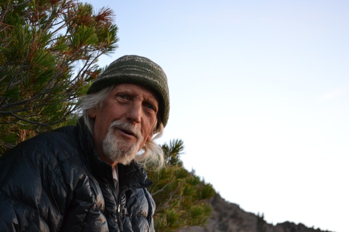Steve, 67-year-old back-packer and Vietnam veteran, watches the sunrise over Granite Lake in the Trinity Alps after a pre-dawn hike.