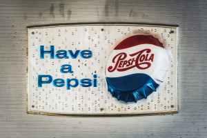 pepsi cola can on blue plastic bag