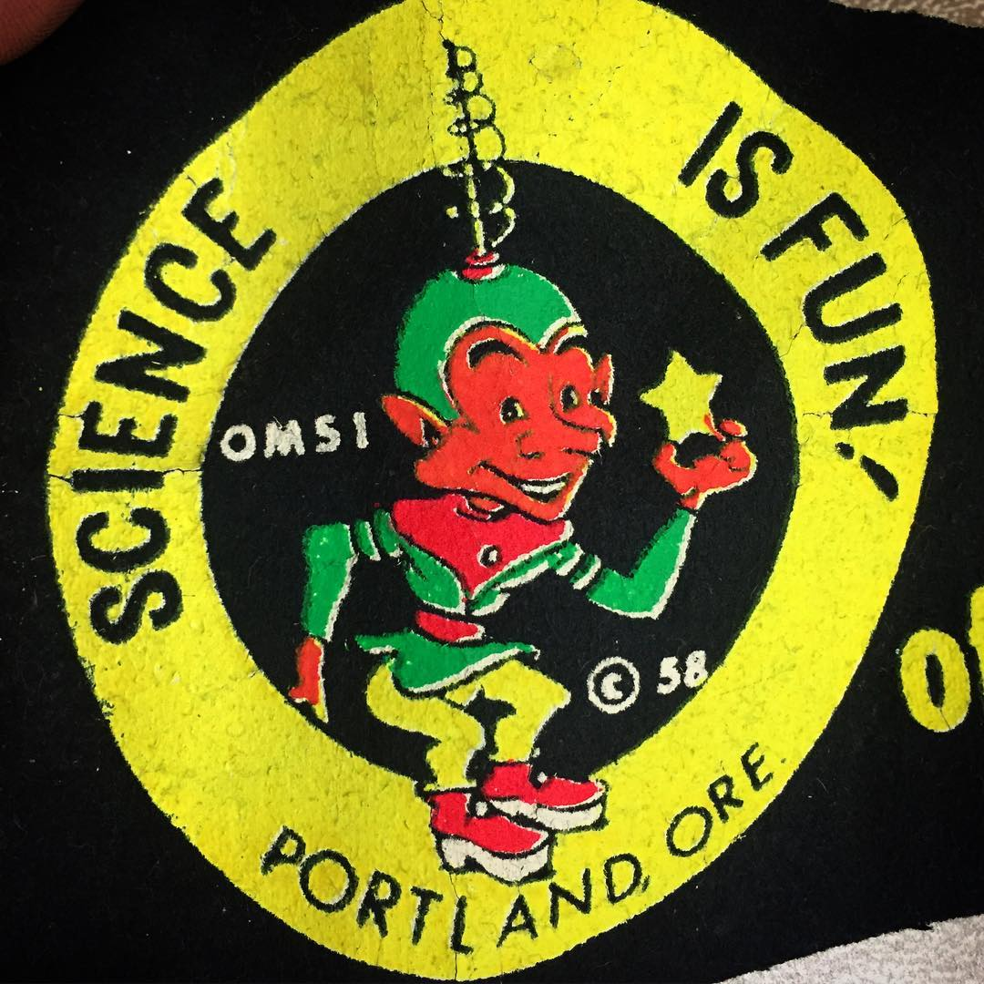 Vintage OMSI Banner Character