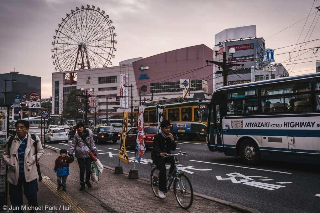 KAGOSHIMA, JAPAN - February 4, 2016: Locals pass by the Kagoshima Chu-o station and Amu Plaza shopping mall around sunset.