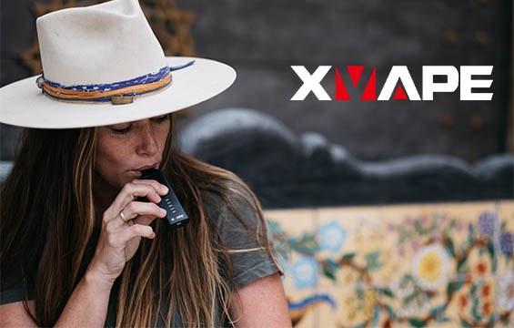 Woman using an XVAPE Herb & Oil Vaporizer