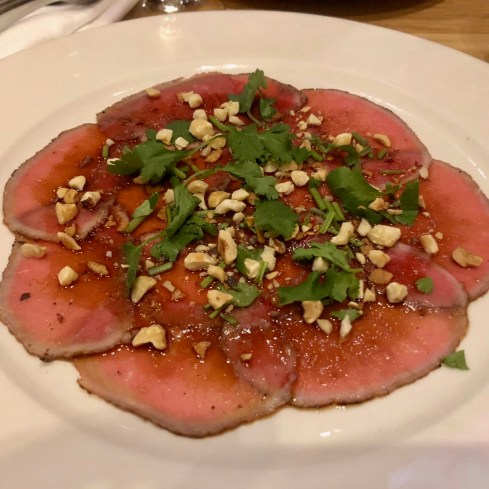 Vietnamese style bison carpaccio, sweet soy and hazelnuts