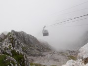 Cable car emerging from the clouds