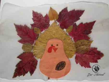 image of turkey placemat made with fall leaves for easy Thanksgiving crafts for kids
