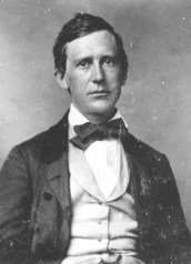 Black and white photograph of man with dark hair and clean shaven face wearing a nice suit and bow tie, Stephen Foster.