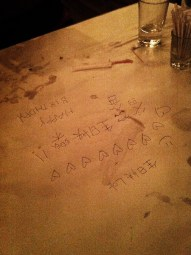 On the table where we'd written birthday wishes upside down; Amaroni's Little Italy