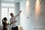 Chef Andre explaining the relationship between ceramic squids and the food philosophy (by Keith Hiro); Restaurant ANDRE