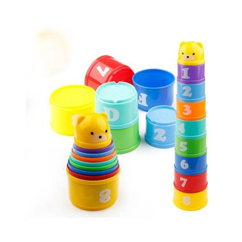 colourful stacking cups, lots of fun for rabbits to toss and chew