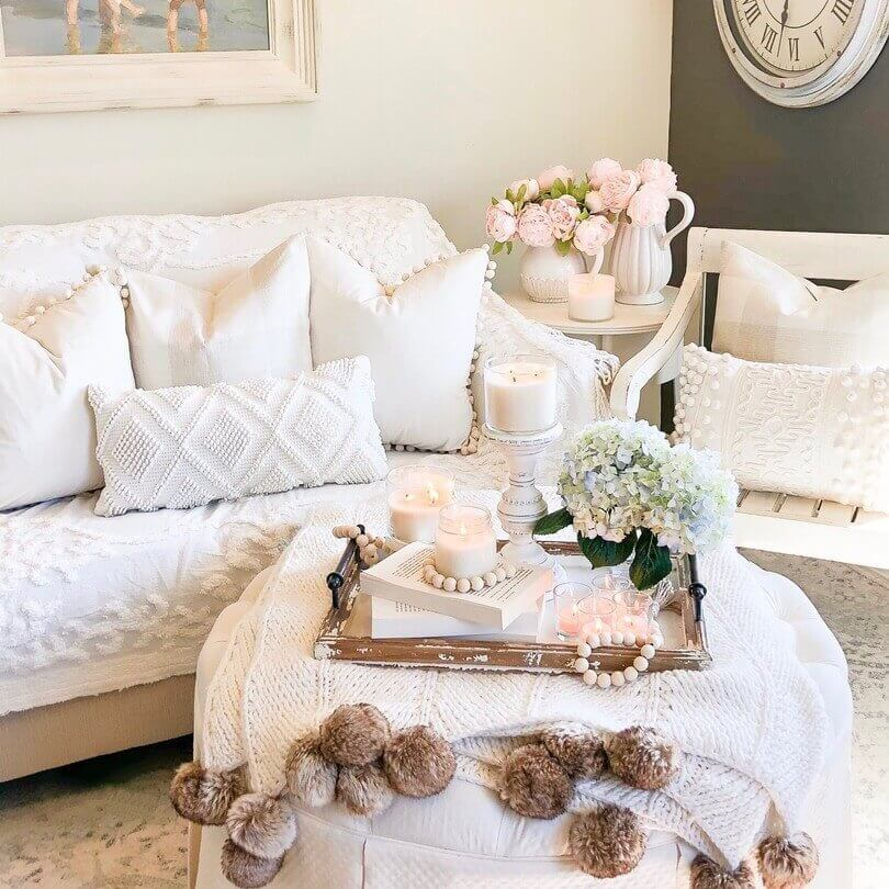 White couch with sea shell accents.