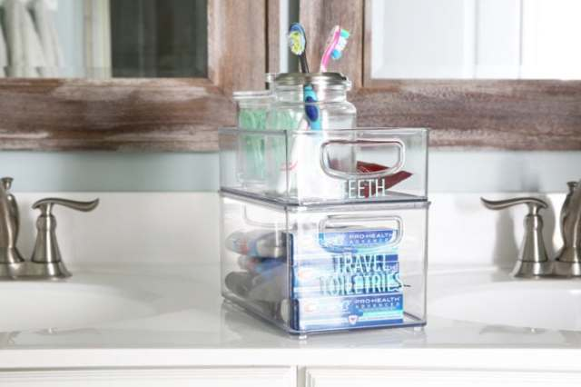 I'm sharing all of my favorite master bathroom organization ideas and some easy updates that we've done to take our master bathroom from cluttered and boring to organized and beautiful! | bathroom organization, organized bathroom vanity, how to organize a bathroom, how to organize deep vanity drawers, organized hair supplies, shaving tools organization, organized dental care items and travel toiletries