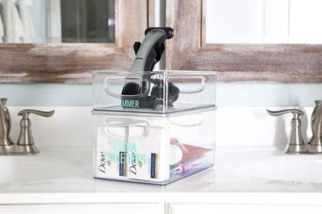 I'm sharing all of my favorite master bathroom organization ideas and some easy updates that we've done to take our master bathroom from cluttered and boring to organized and beautiful! | bathroom organization, organized bathroom vanity, how to organize a bathroom, how to organize deep vanity drawers, organized hair supplies, shaving tools organization, extra toiletries and beard trimmer