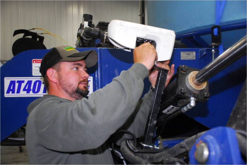 Brad installing GreenSeeker crop sensors for the Farm Journal Test Plots