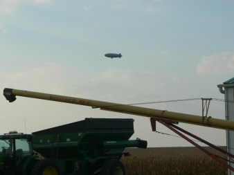 Good Year blimp providing aerial coverage