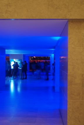 Blue lights led to a busy dance hall...