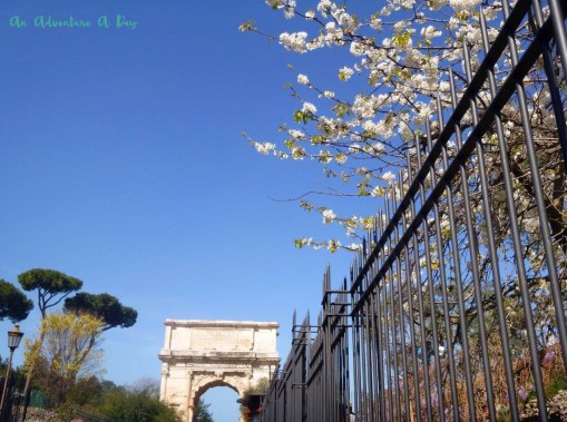 The arch of Titus and spring blossoms on a lovely spring day in Rome.