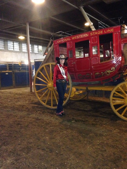 Miss Rodeo Illinois with the stage coach at the NWSSR.