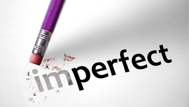 The word imperfect with a pencil eraser erasing the word to perfect.