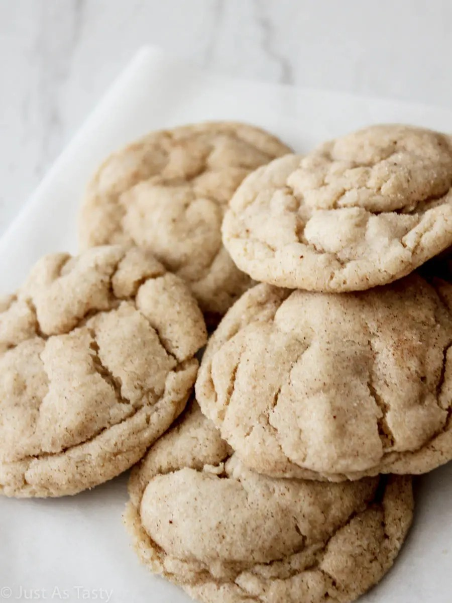 Pile of gluten free snickerdoodles on a white surface.