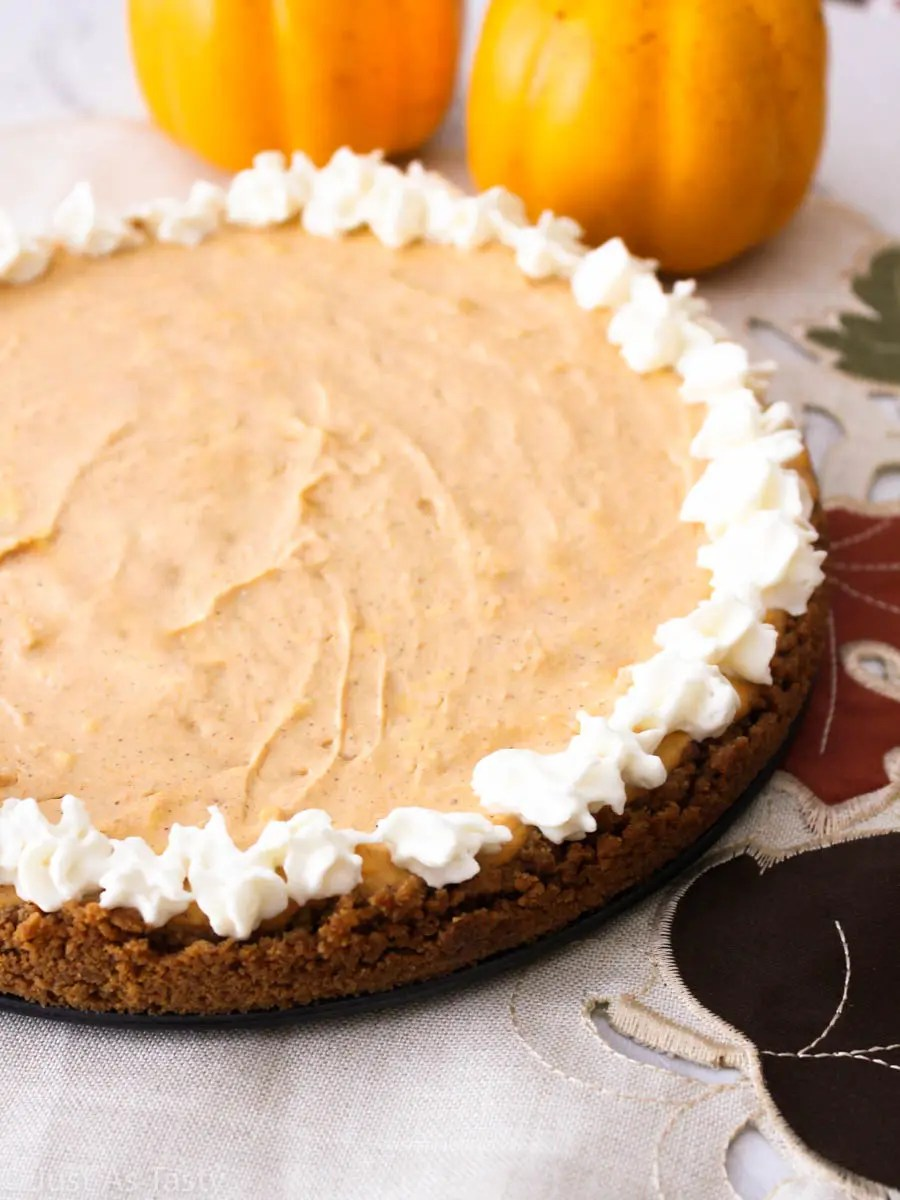 Pumpkin cheesecake with whipped cream topping.