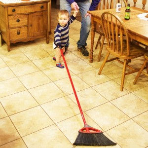 He has a child-size broom, but prefers to use the big one...of course.:-)