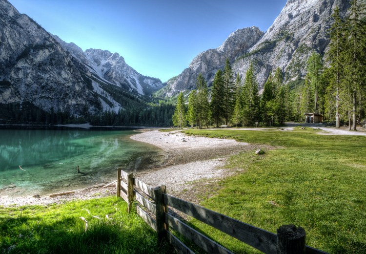 a lake, a forest and towering mountains