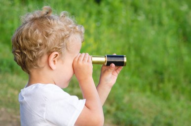 boy looking into the telescope