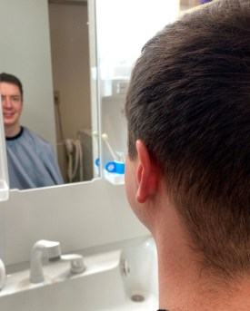 my husband looking in the mirror