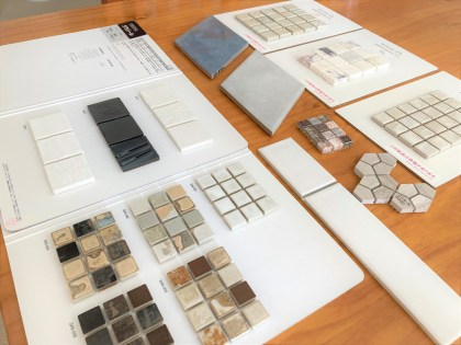 tile samples laid across the table