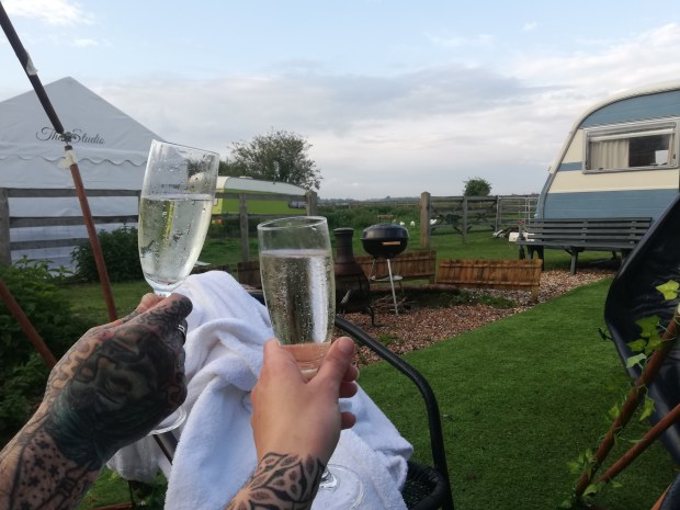 prosecco in hot tub llama farm glamping wisbech
