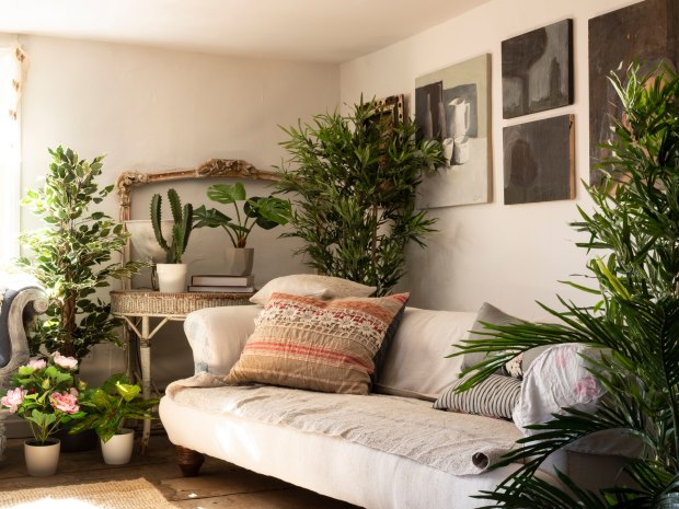 living room with fake plants